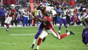 GLENDALE, AZ - DECEMBER 10: Wide receiver John Brown #12 of the Arizona Cardinals attempts to catch the football against safety Anthony Harris #41 of the Minnesota Vikings during the second half of the NFL game at University of Phoenix Stadium on December 10, 2015 in Glendale, Arizona. (Photo by Norm Hall/Getty Images)